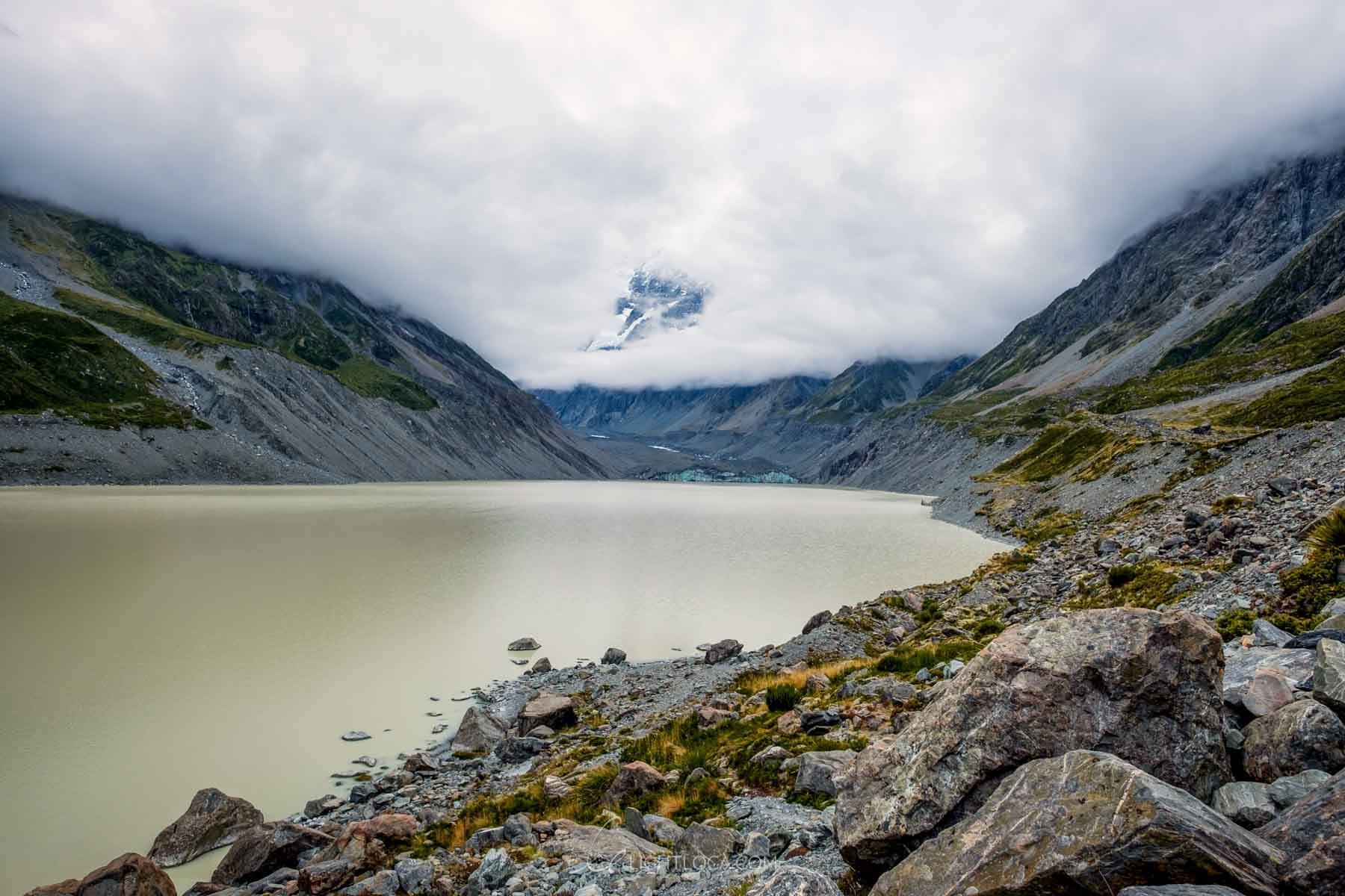 Mount cook peak through clouds New Zealand
