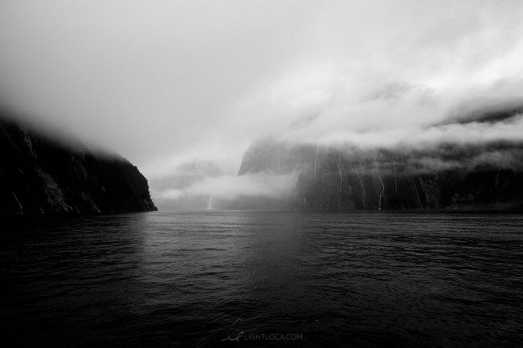 Misty waterfall Milford Sound
