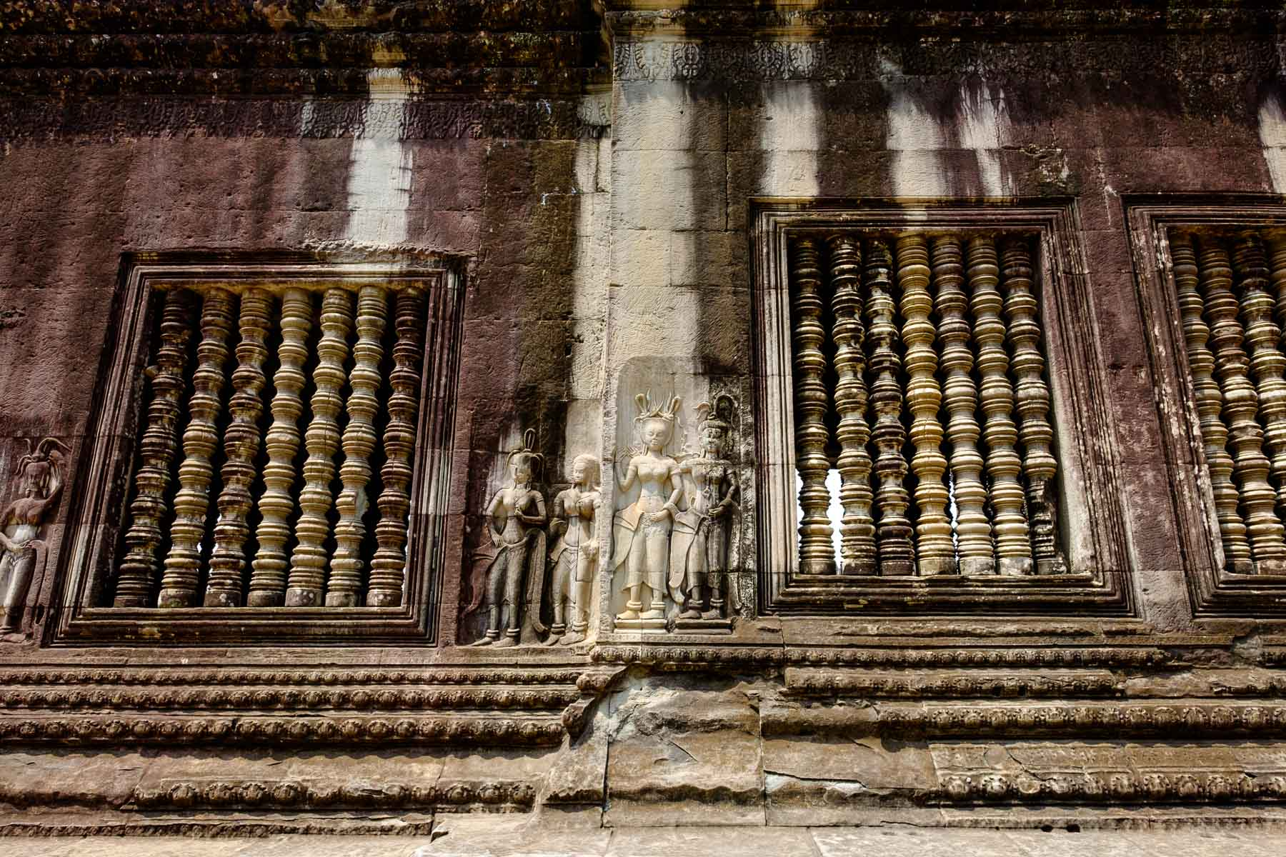 Wall sculptures and window Angkor wat Siem Reap Cambodia