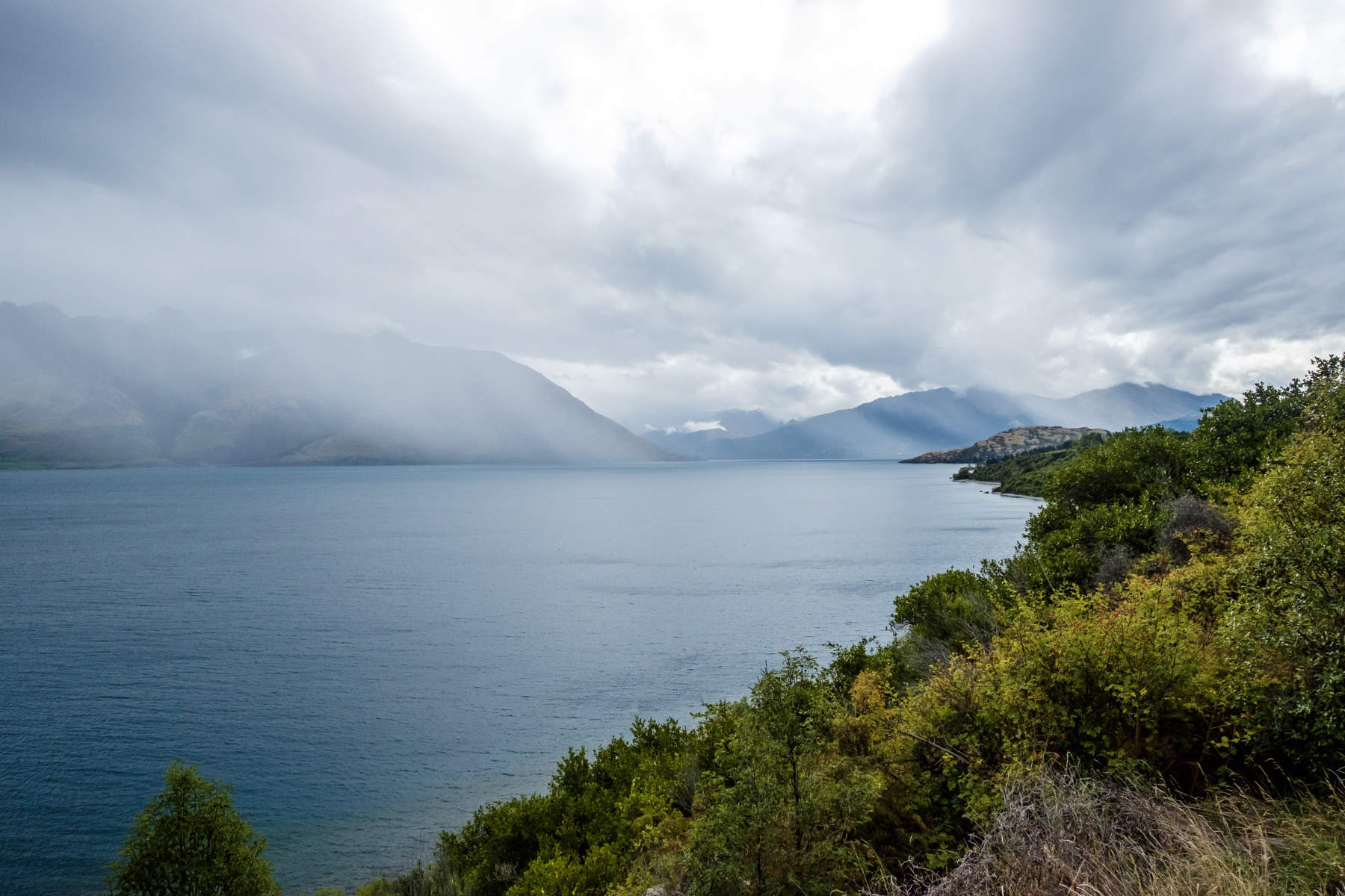Clouds and rain from afar glenorchy New Zealand