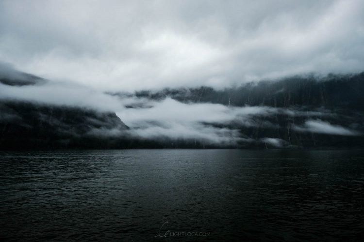 clouds mist milford sound New Zealand