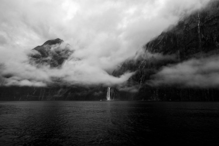 waterfall clouds milford sound New Zealand Light Loca